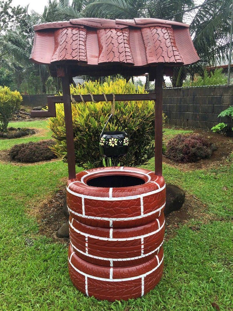 Декоративный колодец из шин или оригинальное украшение сада
